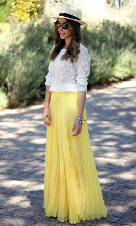 Yellow Skirt With White Top And Hat On Head